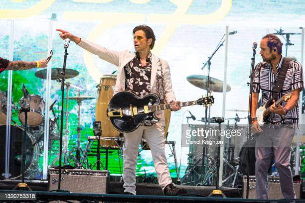 Musician John Stamos of The Beach Boys performs on stage at PETCO Park on May 29, 2021 in San Diego, California.
