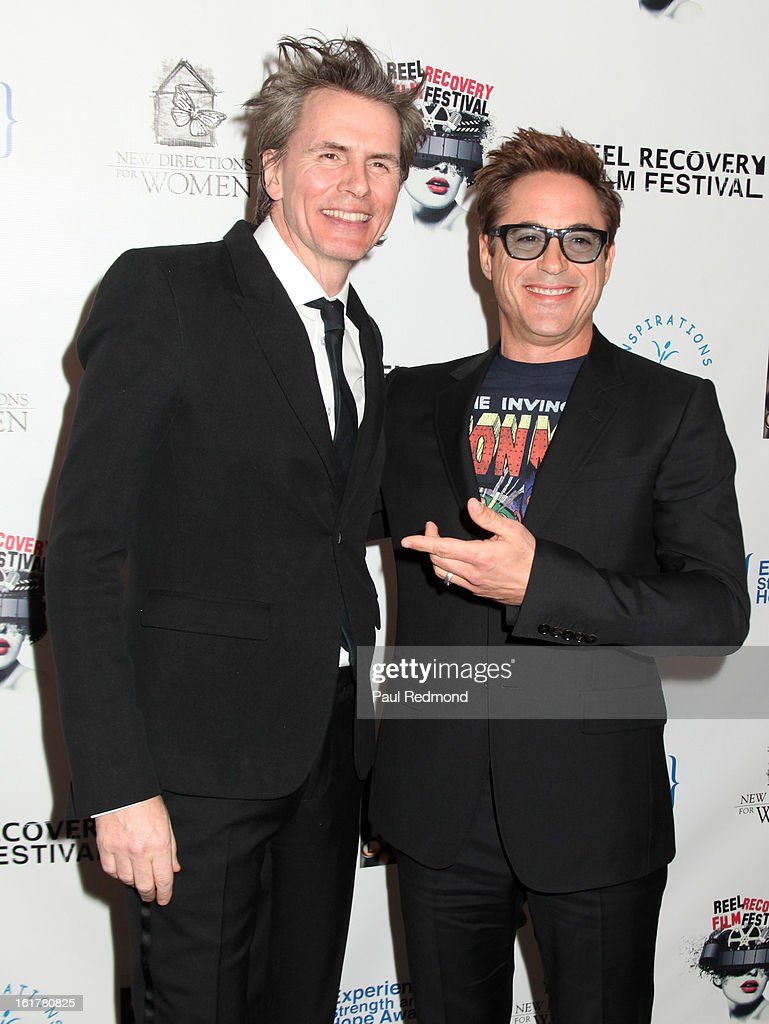 Musician John Taylor and actor Robert Downey Jr. arrive at Writers In Treatment's 4th Annual Experience, Strength And Hope Awards at Skirball Cultural Center on February 15, 2013 in Los Angeles, California.