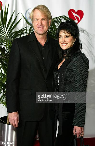 Musician John Tesh and actress Connie Sellecca arrive at the MusiCares 2005 Person of the Year Tribute to Brian Wilson at the Palladium on February...