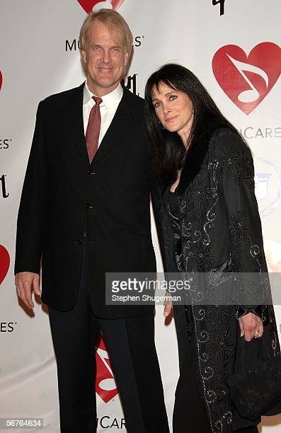 Musician John Tesh and actress Connie Sellecca arrive at the 2006 MusiCares Person of the Year honoring James Taylor at the Los Angeles Convention...