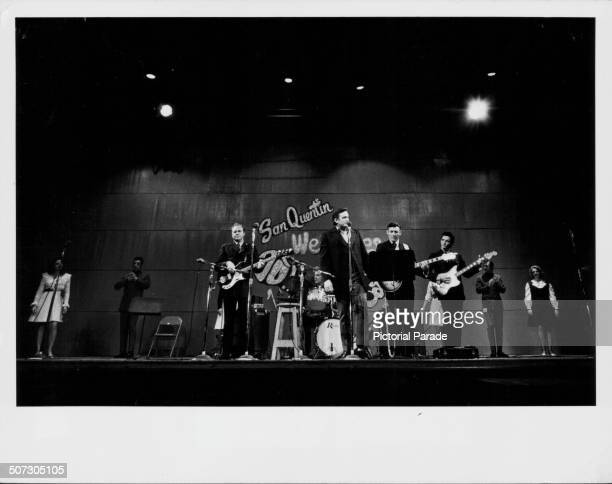 Musician Johnny Cash on stage with his band in concert at San Quentin State Prison California February 24th 1969