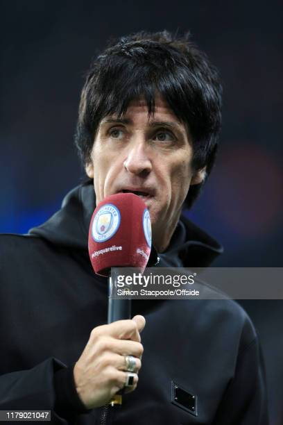 Musician Johnny Marr holds the microphone before the UEFA Champions League group C match between Manchester City and Atalanta at the Etihad Stadium...