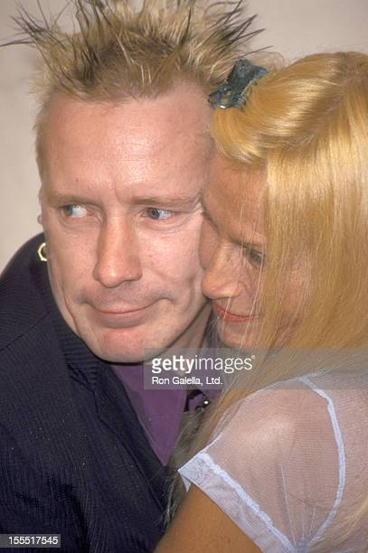 Musician Johnny Rotten of Sex Pistols and wife Nora Forster attend the 2000 VH1/Vogue Fashion Awards on October 20 2000 at Madison Square Garden in...