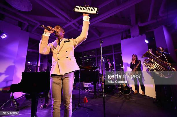 Musician Jon Batiste and Stay Human perform onstage during The Supper hosted by Mario Batali with Anthony Bourdain on June 2 2016 in New York City