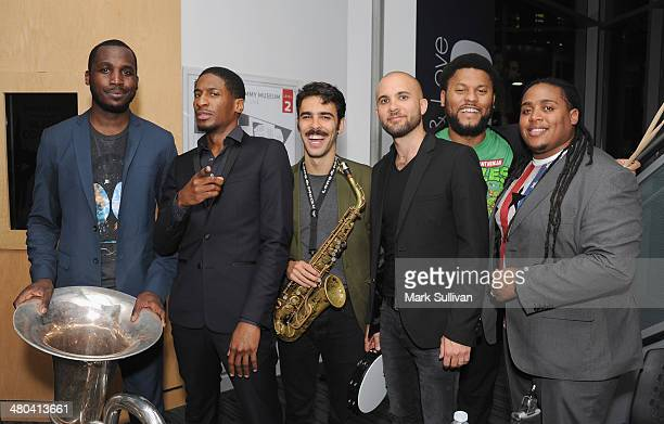 Musician Jon Batiste and Stay Human pose following Spotlight Jon Batiste at The GRAMMY Museum on March 24 2014 in Los Angeles California