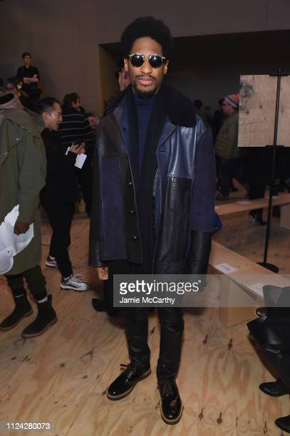Musician Jon Batiste attends Coach 1941 fashion show at the NYSE on February 2019 during New York Fashion Week on February 12 2019 in New York City