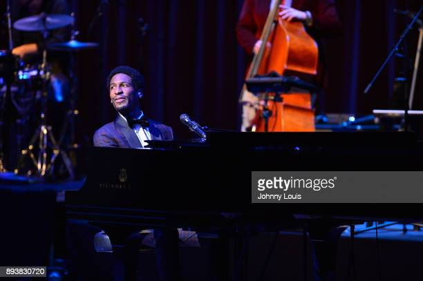 Musician Jon Batiste performs and ring in the holiday season with the 'Jon Batiste and Stay Human' band for The Late Show with Stephen Colbert at...