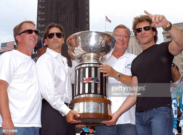 Musician Jon Bon Jovi and fellow team owners pose with the Arena Bowl trophy at a championship rally at City Hall on July 27 2008 in Philadelphia...