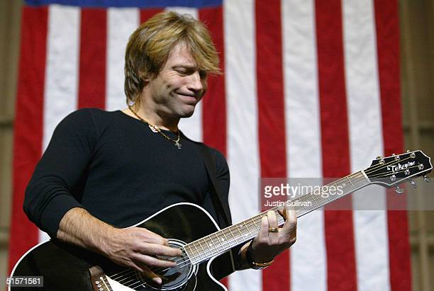 Musician Jon Bon Jovi plays during a rally for Democratic presidential candidate US Senator John Kerry greets supporters during a rally October 25...