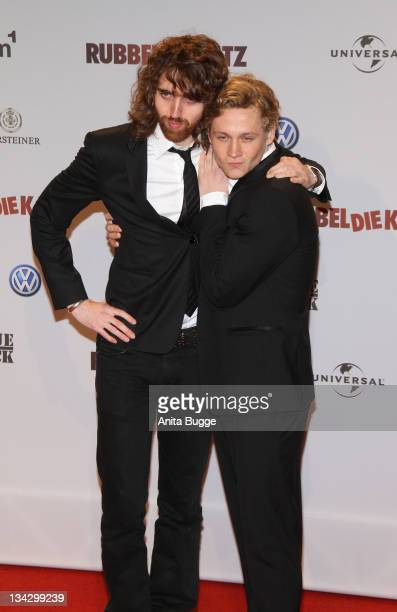Musician Jonathan Jeremiah and actor Matthias Schweighoefer attend the 'RUBBELDIEKATZ' Premiere at Cinemaxx on November 30 2011 in Berlin Germany