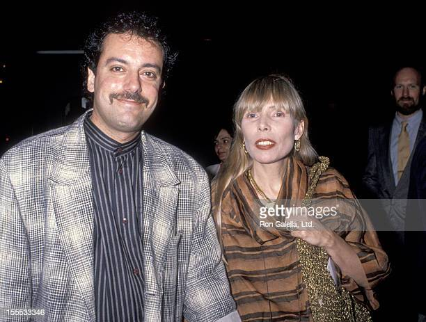 Musician Joni Mitchell and husband Larry Klein attend the Batman Westwood Premiere on June 19, 1989 at Mann Bruin Theatre in Westwood, California.