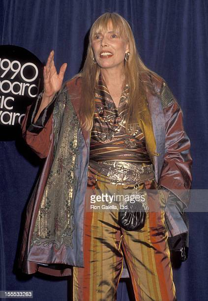 Musician Joni Mitchell attends the First Annual Billboard Music Awards on November 26 1990 at The Barker Hangar The Santa Monica Air Center in Santa...