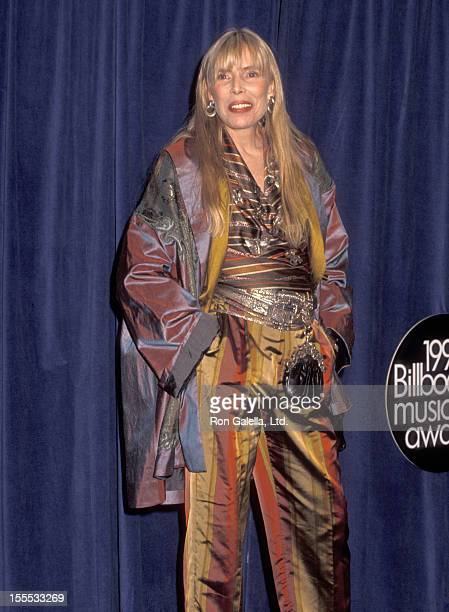 Musician Joni Mitchell attends the First Annual Billboard Music Awards on November 26 1990 at The Barker Hangar The Santa Monica Air Center in Santa...
