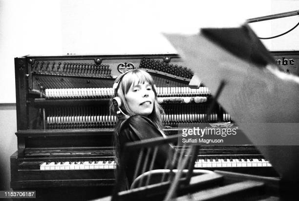 """Musician Joni Mitchell recording her first album """"Song to a Seagull"""" at Sunset Sound Recorders in 1967 in Los Angeles, California."""