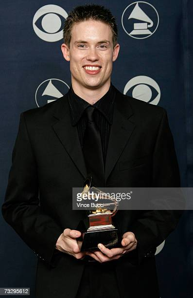 Musician Jonny Land poses with his Grammy for Best Rock Or Rap Gospel Album in the press room at the 49th Annual Grammy Awards at the Staples Center...