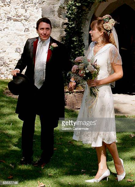Musician Jools Holland and Christabel McEwen are seen after their wedding at St James's Church Cooling on August 30 2005 in Cooling England The...