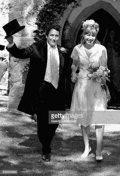 Musician Jools Holland and Christabel McEwen leave their wedding at St James's Church Cooling on August 30 2005 in Cooling England The Archbishop Of...