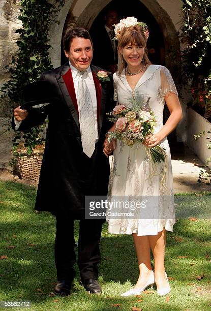 Musician Jools Holland and Christabel McEwen pose at St James's Church Cooling on August 30 2005 in Cooling England The Archbishop Of Canterbury Dr...
