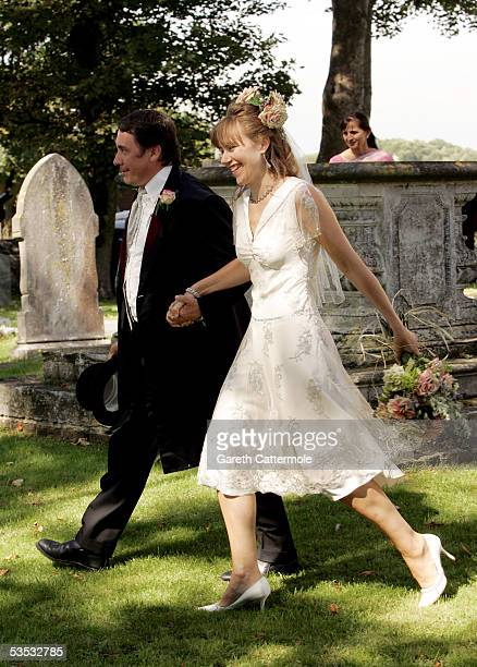 Musician Jools Holland and Christabel McEwen walk in the grounds after their wedding at St James's Church on August 30 2005 in Cooling England The...
