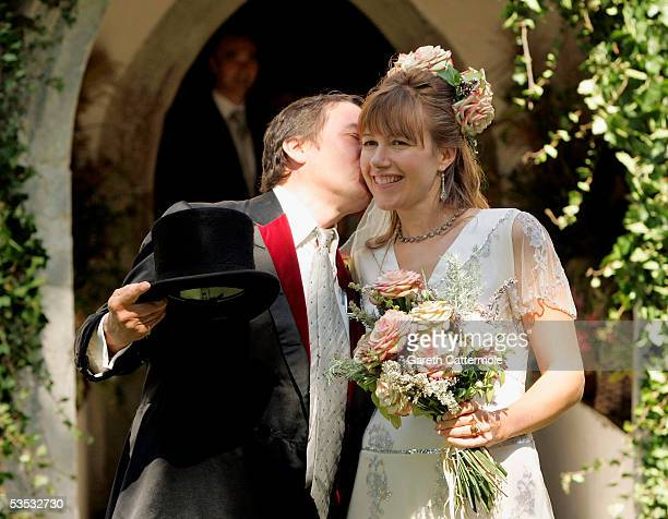 Musician Jools Holland kisses his new wife Christabel McEwen at St James's Church Cooling on August 30 2005 in Cooling England The Archbishop Of...