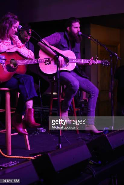 Musician Jordan Davis performs for the CMA Songwriters Series while musician Jillian Jacqueline looks on during the 2018 Sundance Film Festival at...