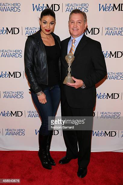 Musician Jordin Sparks and Honoree Dr Frank Papay pose with an award backstage at the 2014 Health Hero Awards hosted by WebMD at Times Center on...