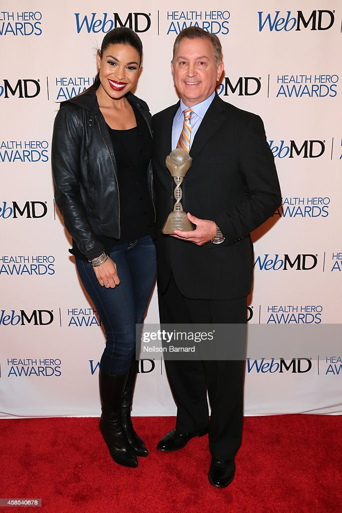 Musician Jordin Sparks (L) and Honoree Dr. Frank Papay pose with an award backstage at the 2014 Health Hero Awards hosted by WebMD at Times Center on November 6, 2014 in New York City.