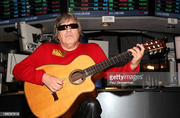 Musician Jose Feliciano plays his guitar after ringing the closing bell at the New York Stock Exchange on December 23 2011 in New York City