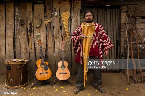 Musician Jose Otaiza 43 in front of his ancestral home's entrance 20 Kms outside Villarica town José grew up in the poorist neighbourhood on the...