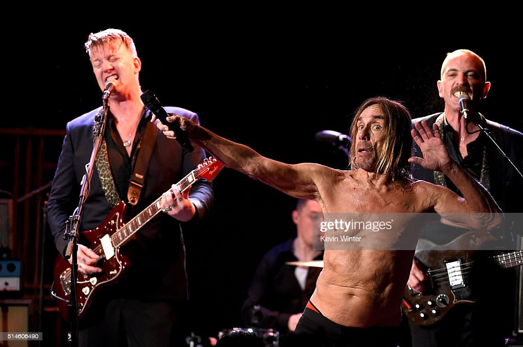 Musician Josh Homme (L) and singer Iggy Pop perform at the Teragram Ballroom for The Post Pop Depression Tour on March 9, 2016 in Los Angeles, California.