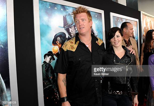 Musician Josh Homme of Queens of the Stone Age and wife musician Brody Dalle of The Distillers arrive at premiere of Warner Bros 'Jonah Hex' held at...