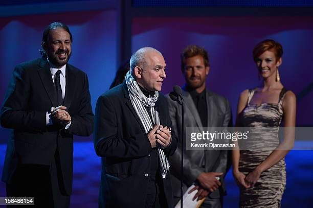 Musician Juan Luis Guerra and producer Jose Tillan accept the Best Long Form Music Video award onstage during the 13th annual Latin GRAMMY Awards...