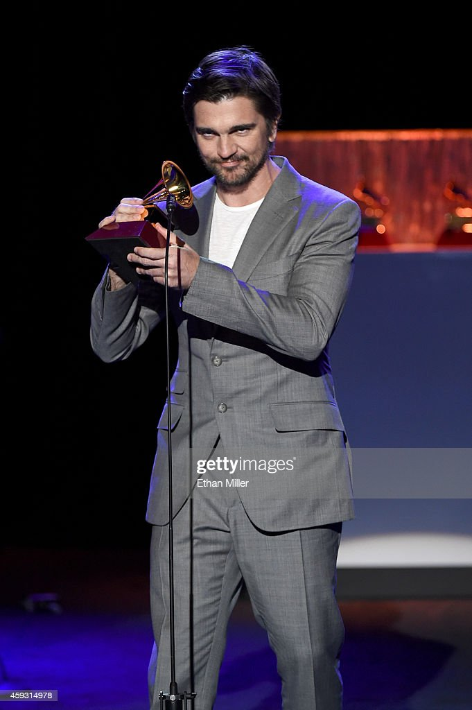 Musician Juanes accepts the Latin Grammy Award for Best Pop/Rock Album 'Loco de Amor' during the 15th annual Latin GRAMMY Awards premiere ceremony at the Hollywood Theatre at the MGM Grand Hotel/Casino on November 20, 2014 in Las Vegas, Nevada.