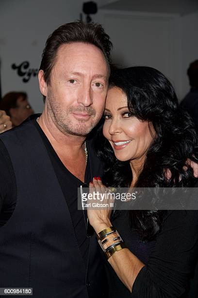 Musician Julian Lennon and Actress Apollonia pose for a photo at the Leica Gallery Los Angeles Presents Mathieu Bittton's Darker Than Blue and Julian...