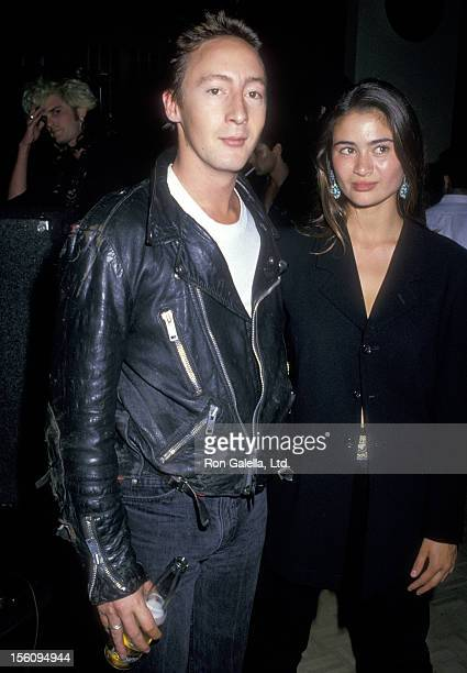 Musician Julian Lennon and actress Charlotte Lewis attend the El Rescate Benefit for Central American Refugees on July 22 1988 at Palette Restaurant...