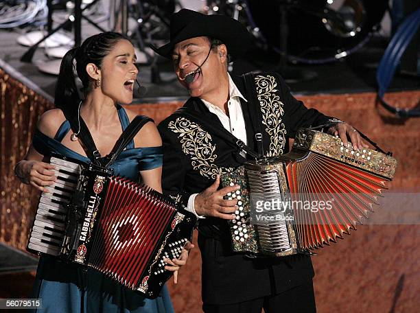 Musician Julieta Venegas and Los Tigres Del Norte perform onstage at the 6th Annual Latin Grammy Awards at the Shrine Auditorium on November 3, 2005...