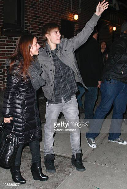 Musician Justin Bieber and his mother Pattie Mallette visit 'Late Show With David Letterman' at the Ed Sullivan Theater on January 31 2011 in New...
