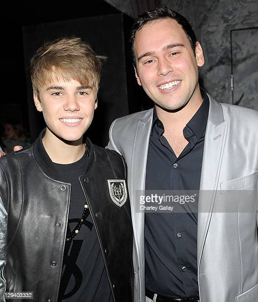 Musician Justin Bieber andScott 'Scooter' Braun attend Scott 'Scooter' Braun's 30th Birthday Party at the Music Box Theater on June 18 2011 in...