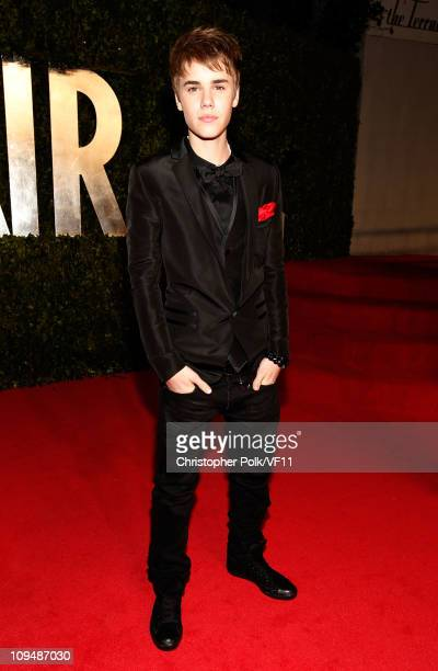 Musician Justin Bieber attends the 2011 Vanity Fair Oscar Party Hosted by Graydon Carter at the Sunset Tower Hotel on February 27 2011 in West...