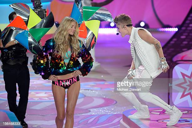 Musician Justin Bieber performs while model Toni Garrn walks the runway during the 2012 Victoria's Secret Fashion Show at the Lexington Avenue Armory...