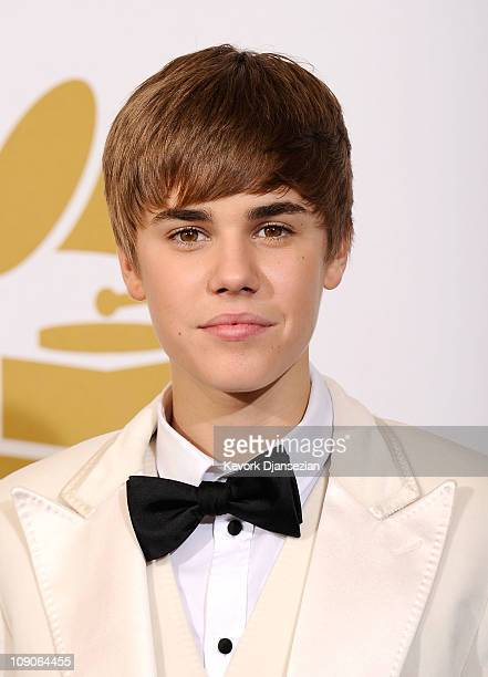 Musician Justin Bieber poses in the press room at The 53rd Annual GRAMMY Awards held at Staples Center on February 13, 2011 in Los Angeles,...