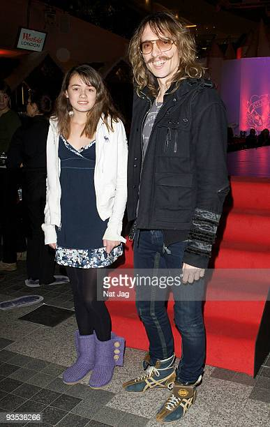 Musician Justin Hawkins and a guest attend the opening of the new Ed Hardy store at Westfield on December 1, 2009 in London, England.