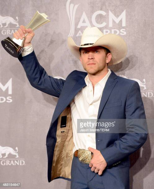 Musician Justin Moore poses in the press room with the Best New Artist award during the 49th Annual Academy of Country Music Awards at the MGM Grand...