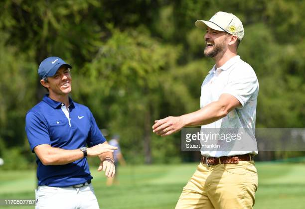 Musician Justin Timberlake and Rory McIlroy of Northern Ireland share a joke during practice prior to the start of the Omega European Masters at...