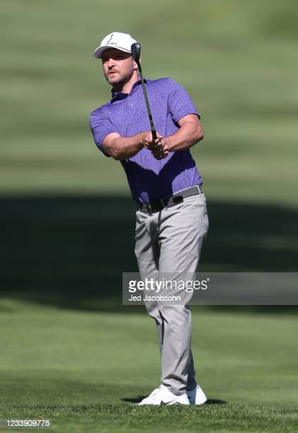 Musician Justin Timberlake hits a shot on the second hole during round two of the American Century Championship at Edgewood Tahoe South golf course...