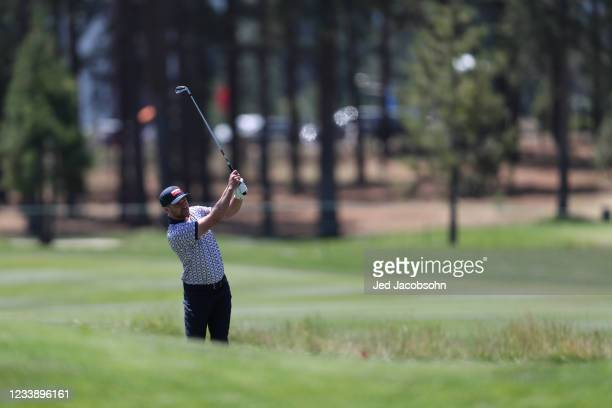 Musician Justin Timberlake hits a shot on the third hole during round one of the American Century Championship at Edgewood Tahoe South golf course on...