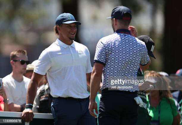 Musician Justin Timberlake, right, and NFL athlete Patrick Mahomes, talk on the third hole during round one of the American Century Championship at...