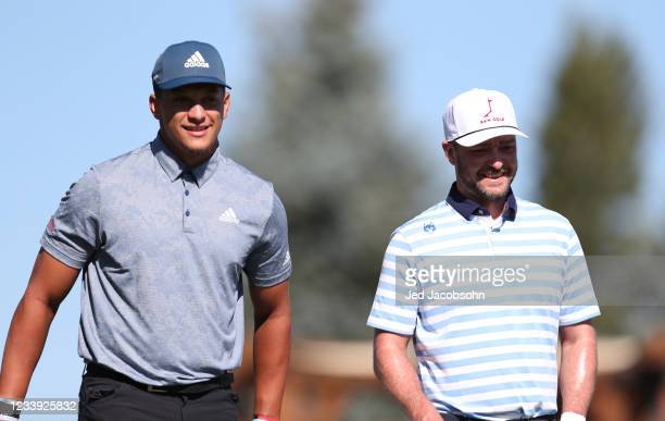Musician Justin Timberlake, right, and NFL athlete Patrick Mahomes wait to tee off from the first hole during the final round of the American Century...
