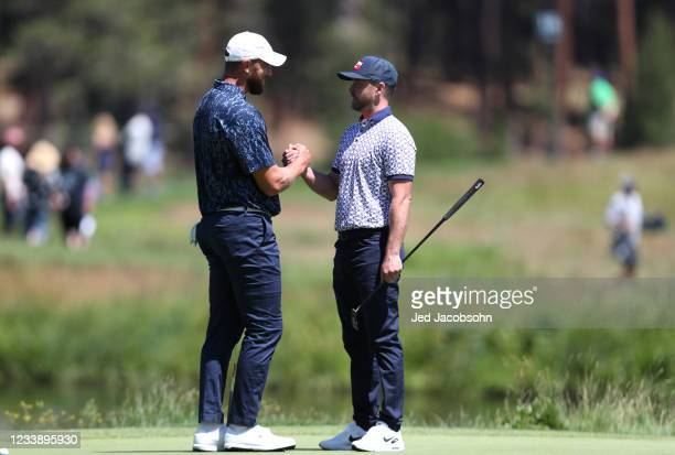 Musician Justin Timberlake, right, and NFL athlete Travis Kelce, shake hands on the first hole during round one of the American Century Championship...