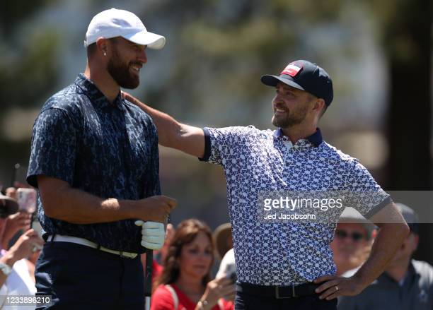Musician Justin Timberlake, right, and NFL athlete Travis Kelce, talk on the third hole during round one of the American Century Championship at...